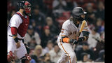 San Francisco Giants' Brandon Crawford, watches the flight of his go-ahead RBI double during the 13th inning of the team's baseball game against the Boston Red Sox at Fenway Park in Boston, Tuesday, Sept. 17, 2019. At left is Red Sox catcher Sandy Leon. (AP Photo/Charles Krupa)