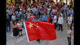 Pro-China supporters wave Chinese national flags in a shopping mall in Hong Kong, Wednesday, Sept. 18, 2019. Activists involved in the pro-democracy protests in Hong Kong appealed to U.S. lawmakers Tuesday to support their fight by banning the export of American police equipment that is used against demonstrators and by more closely monitoring Chinese efforts to undermine civil liberties in the city. (AP Photo/Kin Cheung)