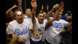 Israeli Prime Minister Benjamin Netanyahu supporters chant as the await results of the elections in Tel Aviv, Israel, Tuesday, Sept. 17, 2019. (AP Photo/Ariel Schalit)