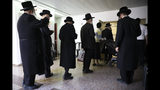 Ultra orthodox Jews line up to vote in Bnei Brak, Israel, Tuesday, Sept. 17, 2019. Israelis began voting Tuesday in an unprecedented repeat election that will decide whether longtime Prime Minister Benjamin Netanyahu stays in power despite a looming indictment on corruption charges. (AP Photo/Oded Balilty)