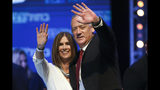 Blue and White party leader Benny Gantz and his wife Revital wave to supporters at party headquarters after the first results of the elections in Tel Aviv, Israel, Wednesday, Sept. 18, 2019. (AP Photo/Oded Balilty)