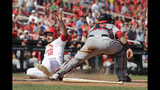 St. Louis Cardinals' Paul DeJong (12) scores past Washington Nationals catcher Yan Gomes during the seventh inning of a baseball game Wednesday, Sept. 18, 2019, in St. Louis. (AP Photo/Jeff Roberson)
