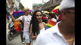 In this Aug. 16, 2019, photo, a participant holds a rainbow flag and marches in a gay pride parade in Kathmandu, Nepal. Nepal seized the lead in equal rights for sexual minorities in South Asia four years ago with a new constitution that forbids all discrimination based on sexual orientation. But activists say progress in equal rights has stalled since the constitution was adopted. (AP Photo/Niranjan Shrestha)