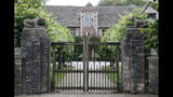 FILE - In this Tuesday, Aug. 6, 2019 file photo is the entrance of the Rooksnest estate near Lambourn, England. The property belongs to the Sackler family, owners of Purdue Pharma based in Stamford, Conn. The allegations surrounding wealthy donors such as the Sackler family have raised questions for the museums they supported, including whether to keep the family's name on prominent galleries. (AP Photo/Frank Augstein, File)