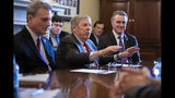 """FILE- In this Feb. 14, 2019, file photo, Sen. Johnny Isakson, R-Ga., flanked by Rep. Buddy Carter R-Ga., left, and Sen. David Perdue, R-Ga., right, leads a meeting on Capitol Hill in Washington. Sen. Isakson announced on Wednesday, Aug. 28, 2019, that he will retire at the end of 2019, citing """"health challenges."""" (AP Photo/J. Scott Applewhite, File)"""