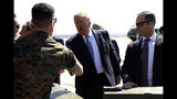 President Donald Trump greets supporters as he arrives at Marine Corps Air Station Miramar to attend a fundraiser and visit a section of the border wall, Wednesday, Sept. 18, 2019, in San Diego. (AP Photo/Evan Vucci)