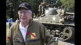 World War II veteran Clarence Smoyer, 96, poses for a picture in front of a Sherman tank after receiving the Bronze Star, near the World War II Memorial, Wednesday, Sept. 18, 2019, in Washington. Smoyer fought with the U.S. Army's 3rd Armored Division, nicknamed the Spearhead Division. In 1945, he defeated a German Panther tank near the cathedral in Cologne, Germany - a dramatic duel filmed by an Army cameraman that was seen all over the world. (AP Photo/Alex Brandon)
