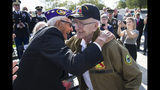 World War II veterans Joseph Caserta, left, and Clarence Smoyer, 96, embrace before a ceremony to present the Bronze Star to Smoyer at the World War II Memorial, Wednesday, Sept. 18, 2019, in Washington. Smoyer fought with the U.S. Army's 3rd Armored Division, nicknamed the Spearhead Division. In 1945, he defeated a German Panther tank near the cathedral in Cologne, Germany - a dramatic duel filmed by an Army cameraman that was seen all over the world. (AP Photo/Alex Brandon)