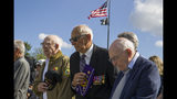 World War II veterans Clarence Smoyer, 96, left, Joseph Caserta and Buck Marsh bow their heads during a ceremony to present the Bronze Star to Smoyer at the World War II Memorial, Wednesday, Sept. 18, 2019, in Washington. Smoyer fought with the U.S. Army's 3rd Armored Division, nicknamed the Spearhead Division. In 1945, he defeated a German Panther tank near the cathedral in Cologne, Germany - a dramatic duel filmed by an Army cameraman that was seen all over the world. (AP Photo/Alex Brandon)