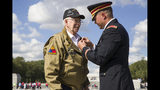 World War II veteran Clarence Smoyer, 96, receives the Bronze Star from U.S. Army Maj. Peter Semanoff at the World War II Memorial, Wednesday, Sept. 18, 2019, in Washington. Smoyer fought with the U.S. Army's 3rd Armored Division, nicknamed the Spearhead Division. In 1945, he defeated a German Panther tank near the cathedral in Cologne, Germany - a dramatic duel filmed by an Army cameraman that was seen all over the world. (AP Photo/Alex Brandon)