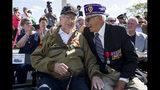 World War II veterans Clarence Smoyer, 96, left, and Joseph Caserta smile after Smoyer was presented the Bronze Star at the World War II Memorial, Wednesday, Sept. 18, 2019, in Washington. Smoyer fought with the U.S. Army's 3rd Armored Division, nicknamed the Spearhead Division. In 1945, he defeated a German Panther tank near the cathedral in Cologne, Germany - a dramatic duel filmed by an Army cameraman that was seen all over the world. (AP Photo/Alex Brandon)
