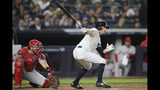 New York Yankees' Brett Gardner, right, watches his RBI-double during the sixth inning of a baseball game against the Los Angeles Angels, Thursday, Sept. 19, 2019, in New York. (AP Photo/Mary Altaffer)