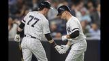 New York Yankees' Brett Gardner celebrates with Clint Frazier (77) after hitting a solo home run during the fourth inning of a baseball game against the Los Angeles Angels, Thursday, Sept. 19, 2019, in New York. (AP Photo/Mary Altaffer)