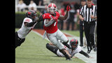 Georgia running back D'Andre Swift (7) turns the corner on a pass play which he broke for a touchdown during the first half of an NCAA college football game in Athens, Ga. (Bob Andres/Atlanta Journal-Constitution via AP)