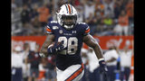 FILE - In this Aug. 31, 2019, file photo, Auburn running back JaTarvious Whitlow (28) runs against Oregon during the second half of an NCAA college football game, in Arlington, Texas. No. 8 Auburn has been leaning heavily on JaTarvious Whitlow to power a running game that's key in supporting freshman quarterback Bo Nix. (AP Photo/Ron Jenkins, File)