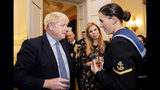 "Britain's Prime Minister Boris Johnson and his girlfriend Carrie Symonds, center, speak to guests at a military reception held at 10 Downing Street, London, Wednesday, Sept. 18, 2019. Johnson was accused by European Union officials Wednesday of failing to negotiate seriously and branded the ""father of lies"" by a lawyer in the U.K. Supreme Court, as his plan to leave the EU in just over six weeks faced hurdles on both sides of the Channel. (Jon Nguyen/Pool Photo via AP)"