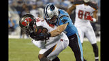 Carolina Panthers middle linebacker Luke Kuechly, right, tackles Tampa Bay Buccaneers running back Peyton Barber during the first half of an NFL football game in Charlotte, N.C., Thursday, Sept. 12, 2019. (AP Photo/Brian Blanco)