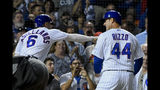 Chicago Cubs' Anthony Rizzo (44) celebrates with Nicholas Castellanos, left, after Rizzo hit a home run against the St. Louis Cardinals during the third inning of a baseball game Thursday, Sept. 19, 2019, in Chicago. (AP Photo/Matt Marton)