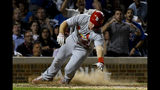 St. Louis Cardinals' Paul Goldschmidt scores during the sixth inning of a baseball game against the Chicago Cubs, Thursday, Sept. 19, 2019, in Chicago. (AP Photo/Matt Marton)