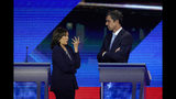 Democratic presidential candidates Sen. Kamala Harris, D-Calif., left and former Texas Rep. Beto O'Rourke talk Thursday, Sept. 12, 2019, during a break at a Democratic presidential primary debate hosted by ABC at Texas Southern University in Houston. (AP Photo/David J. Phillip)