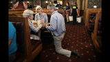 Republican presidential candidate, former South Carolina Gov. Mark Sanford talks with customers at the Puritan Backroom restaurant, during a campaign stop, Thursday, Sept. 19, 2019, in Manchester, N.H. (AP Photo/Elise Amendola)