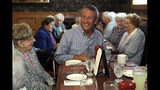 Republican presidential candidate, former South Carolina Gov. Mark Sanford, right, chats with patrons at the Puritan Backroom restaurant, during a campaign stop, Thursday, Sept. 19, 2019, in Manchester, N.H. (AP Photo/Elise Amendola)