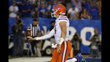 Florida quarterback Kyle Trask (11) flips the ball in the air after running in for a touchdown during the second half of the team's NCAA college football game against Kentucky in Lexington, Ky., Saturday, Sept. 14, 2019. Florida won 29-21. (AP Photo/Timothy D. Easley)
