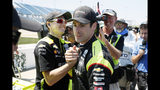 FILE - In this July 19, 2019, file photo, Simon Pagenaud celebrates with crew members after winning the pole position for an IndyCar Series auto race at Iowa Speedway in Newton, Iowa. Pagenaud is third in the IndyCar standings heading into this weekend's IndyCar finale at Laguna Seca Raceway in Monterey, Calif. (AP Photo/Charlie Neibergall, File)