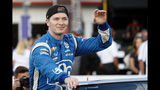 FILE - In this Aug. 24, 2019, file photo, Josef Newgarden waves before an IndyCar auto race at World Wide Technology Raceway in Madison, Ill. Newgarden can win his second IndyCar championship in three years in the season finale at historic Laguna Seca on Sunday. (AP Photo/Jeff Roberson, File)