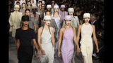 Models Gigi Hadid, from front second left, Bella Hadid and Kaia Gerber wear creations with other models as part of the Max Mara Spring-Summer 2020 collection, unveiled during the fashion week, in Milan, Italy, Thursday, Sept. 19, 2019. (AP Photo/Luca Bruno)