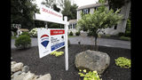 FILE - In this July 22, 2019, file photo a sign is displayed outside a house for sale in North Andover, Mass. On Thursday, Sept. 19, Freddie Mac reports on this week's average U.S. mortgage rates. (AP Photo/Elise Amendola, File)