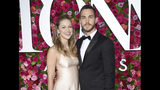 FILE - This June 10, 2018 file photo shows Melissa Benoist, left, and Chris Wood at the 72nd annual Tony Awards in New York. Benoist and Wood will join performers Jane Lynch, Wayne Brady and Laurie Metcalf for a concert being livestreamed Saturday, Sept. 21, 2019, to benefit low-income migrants. The concert is set for 6 p.m. PDT at UCLA's Royce Hall. It will be broadcast via Facebook Live and at ConcertsforAmerica.com. Proceeds will benefit the National Immigration Law Center. (Photo by Evan Agostini/Invision/AP, File)