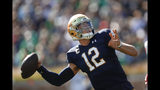 Notre Dame quarterback Ian Book throws in the first half of an NCAA college football game against New Mexico in South Bend, Ind., Saturday, Sept. 14, 2019. (AP Photo/Paul Sancya)