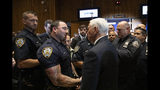 Vice President Mike Pence, right, meets with members of the New York Police Department's football team, Thursday, Sept. 19, 2019. Pence met earlier with the NYPD for a counterterrorism briefing. (AP Photo/Mark Lennihan)