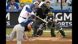 Los Angeles Dodgers' Max Muncy hits a two-run double as Tampa Bay Rays starting pitcher Brendan McKay watches along with catcher Travis d'Arnaud, right, and home plate umpire Adrian Johnson during the second inning of a baseball game Wednesday, Sept. 18, 2019, in Los Angeles. (AP Photo/Mark J. Terrill)