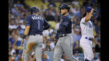 Tampa Bay Rays' Willy Adames, left, and Austin Meadows, center, congratulate each other after they scored on a double by Tommy Pham off Los Angeles Dodgers relief pitcher Tony Gonsolin, right, during the fifth inning of a baseball game Wednesday, Sept. 18, 2019, in Los Angeles. (AP Photo/Mark J. Terrill)