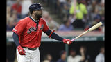 Cleveland Indians' Franmil Reyes watches his two-run home run in the fourth inning in a baseball game against the Detroit Tigers, Thursday, Sept. 19, 2019, in Cleveland. Yasiel Puig scored on the play. (AP Photo/Tony Dejak)