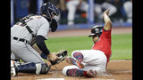 Cleveland Indians' Francisco Lindor, right, scores ahead of the tag from Detroit Tigers catcher Grayson Greiner in the first inning in a baseball game Thursday, Sept. 19, 2019, in Cleveland. (AP Photo/Tony Dejak)