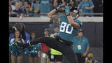 Jacksonville Jaguars tight end James O'Shaughnessy pulls in a 7-yard touchdown pass against the Tennessee Titans during the first half of an NFL football game Thursday, Sept. 19, 2019, in Jacksonville, Fla. (AP Photo/Phelan Ebenhack)