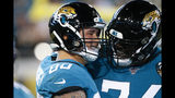 Jacksonville Jaguars tight end James O'Shaughnessy (80) celebrates his touchdown reception against the Tennessee Titans with offensive tackle Cam Robinson during the first half of an NFL football game, Thursday, Sept. 19, 2019, in Jacksonville, Fla. (AP Photo/Stephen B. Morton)