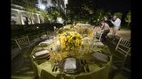 Two tables are set during a media preview for the State Dinner with President Donald Trump and Australian Prime Minister Scott Morrison in the Rose Garden of the White House, Thursday, Sept. 19, 2019, in Washington. (AP Photo/Alex Brandon)