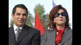 FILE - In this Nov.7, 2007 file photo, Tunisian President Zine EL Abidine Ben Ali and his wife Leila are seen in Rades, outside Tunis, marking the 20th anniversary of Ben Ali's presidency. Tunisia's autocratic ruler Zine El Abidine Ben Ali, toppled in 2011, died in exile in Saudi Arabia. (AP Photo/Hassene Dridi, File)