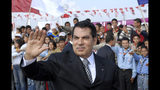 FILE - In this Nov.7, 2007 file photo, Tunisian President Zine EL Abidine Ben Ali waves to supporters in Rades, outside Tunis, before celebrations marking the 20th anniversary of Ben Ali's presidency. Tunisia's autocratic ruler Zine El Abidine Ben Ali, toppled in 2011, died in exile in Saudi Arabia. (AP Photo/Hassene Dridi, File)