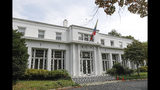 This Sept. 17, 2019, photo shows the main entrance to the Venezuelan Ambassador's residence in Washington. U.S. officials are investigating the possible looting from Venezuela of valuable European and Latin American artwork they believe is being quietly plundered by government insiders as Nicolas Maduro struggles to keep his grip on power. (AP Photo/Pablo Martinez Monsivais)
