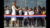 First lady Melania Trump high-fives students from Amidon-Bowen Elementary School in Washington as she arrives at a ribbon-cutting ceremony to re-open the Washington Monument, Thursday, Sept. 19, 2019, in Washington. The monument has been closed to the public for renovations since August 2016. (AP Photo/Patrick Semansky)
