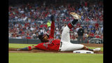 Atlanta Braves center fielder Ronald Acuna Jr. reacts as he advances to third base on an Ozzie Albies double in the first inning of a baseball game against the San Francisco Giants, Friday, Sept. 20, 2019, in Atlanta. (AP Photo/John Bazemore)