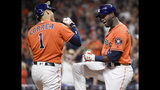 Houston Astros' Carlos Correa (1) celebrates his two-run home run off Los Angeles Angels starting pitcher Jaime Barria with Yordan Alvarez during the first inning of a baseball game, Friday, Sept. 20, 2019, in Houston. (AP Photo/Eric Christian Smith)
