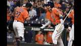 Houston Astros' Jose Altuve, left, celebrates his solo home run off Los Angeles Angels starting pitcher Jaime Barria with Alex Bregman during the first inning of a baseball game Friday, Sept. 20, 2019, in Houston. (AP Photo/Eric Christian Smith)