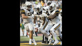 Appalachian State defensive back Shaun Jolly (3) celebrates with teammates inside linebacker Jordan Fehr (59) and outside linebacker Noel Cook (20) after making an interception over Charlotte wide receiver Victor Tucker (9) in the fourth quarter of an NCAA college football game in Boone, N.C., Saturday, Sept. 7, 2019 Appalachian State won, 56-41. (Allison Lee Isley/The Winston-Salem Journal via AP)