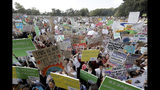 "Thousands of protestors, many of them school students, gather in Sydney, Friday, Sept. 20, 2019, calling for action to guard against climate change. Australia's acting Prime Minister Michael McCormack has described ongoing climate rallies as ""just a disruption"" that should have been held on a weekend to avoid inconveniencing communities. (AP Photo/Rick Rycroft)"